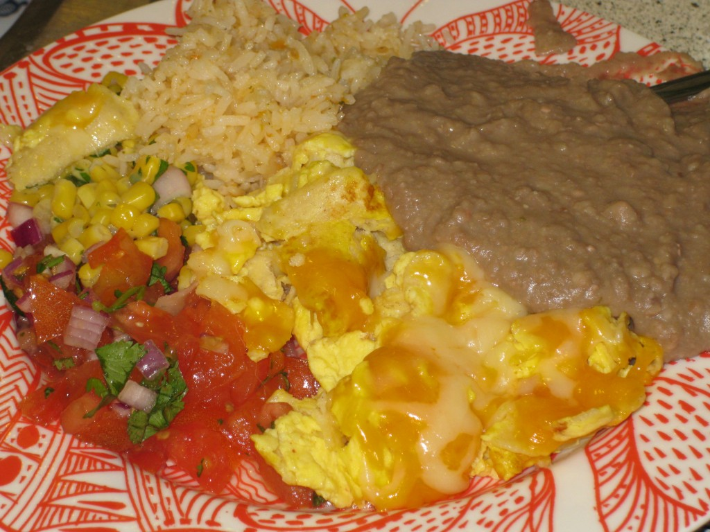 Migas with Corn Salsa, Pico de Gallo, Rice and Refried Beans